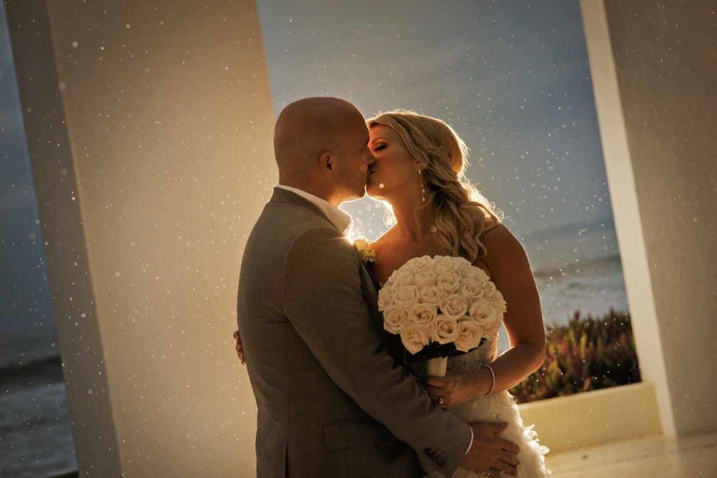 Mexico Rainstorm Kiss | Destination Wedding Photographer | SLIVER Photography