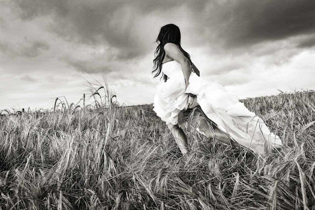Bride running in field   Destination Wedding Photographer   SLIVER Photography